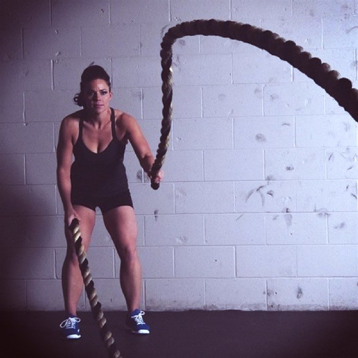 Woman on battle ropes working out